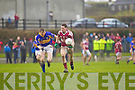 Scartaglin's David Murphy breaks away from John O'Donovan of Diarmuid Mathunas, Cork in the Munster Novice Final last SUnday in Knockaderry.