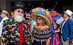 LOUISVILLE, KY - MAY 05: A man and woman wear their Derby finest on Kentucky Derby Day at Churchill Downs on May 5, 2018 in Louisville, Kentucky. (Photo by Eric Patterson/Eclipse Sportswire/Getty Images)