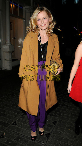 EMILIA FOX .At the Mamas & Papas 30th Anniversary Party, Mamas & Papas store, Regent Street, London, England, UK, .March 7th 2011..full length camel brown mustard coat purple trousers black top clutch bag shoes open toe platform peep necklace walking .CAP/CAN.©Can Nguyen/Capital Pictures.