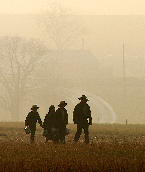 An Amish father escorts his children toward the New Hope Amish School on its opening day April, 2, 2007 in Nickel Mines, PA. Six months ago to the day a gunman entered the Nickel Mines Amish school allowing a teacher and the male students to escape then he shot 10 Amish girls, killing five of them. (The New York Timers/Bradley C Bower)