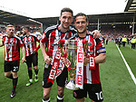 Sheffield United's Chris Basham and Billy Sharp celebrate with the trophy during the League One match at Bramall Lane, Sheffield. Picture date: April 30th, 2017. Pic David Klein/Sportimage
