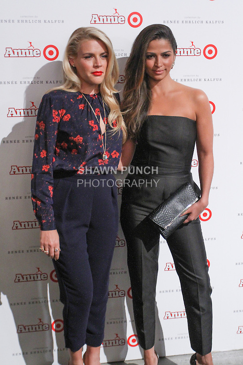 Actress Busy Philipps (left) and model Camila Alves arrive at the Annie For Target collection celebration and pop-up shop at Stage 37 in New York City on November 4, 2014.