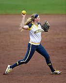 Michigan Wolverines utility player Kelsey Susalla (7) throws to first during the season opener against the Florida Gators on February 8, 2014 at the USF Softball Stadium in Tampa, Florida.  Florida defeated Michigan 9-4 in extra innings.  (Copyright Mike Janes Photography)