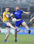 Gary Brennan of Clare in action against David Murray of Roscommon during their National League game at Cusack Park. Photograph by John Kelly.