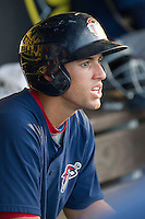 Oklahoma City RedHawks outfielder George Springer (8) in the dugout against the Round Rock Express during the Pacific Coast League baseball game on August 25, 2013 at the Dell Diamond in Round Rock, Texas. Round Rock defeated Oklahoma City 9-2. (Andrew Woolley/Four Seam Images)