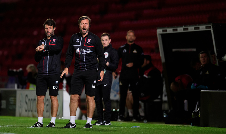 Lincoln City manager Danny Cowley, left, and Lincoln City's assistant manager Nicky Cowley<br /> <br /> Photographer Chris Vaughan/CameraSport<br /> <br /> EFL Leasing.com Trophy - Northern Section - Group H - Doncaster Rovers v Lincoln City - Tuesday 3rd September 2019 - Keepmoat Stadium - Doncaster<br />  <br /> World Copyright © 2018 CameraSport. All rights reserved. 43 Linden Ave. Countesthorpe. Leicester. England. LE8 5PG - Tel: +44 (0) 116 277 4147 - admin@camerasport.com - www.camerasport.com