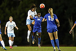 16 October 2015: North Carolina's Abby Elinsky (8) heads the ball over Duke's Toni Payne (10). The University of North Carolina Tar Heels hosted the Duke University Blue Devils at Fetzer Field in Chapel Hill, NC in a 2015 NCAA Division I Women's Soccer game. Duke won the game 1-0.