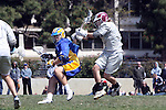 Los Angeles, CA 04/11/09 -  Five on five, Ryan Sanders (UCSB#5) tries to move around Justin Hirigoyen (LMU #5) in the second period of UCSB's visit at LMU with a playoff berth at stake, UCSB defeated LMU 12-9..