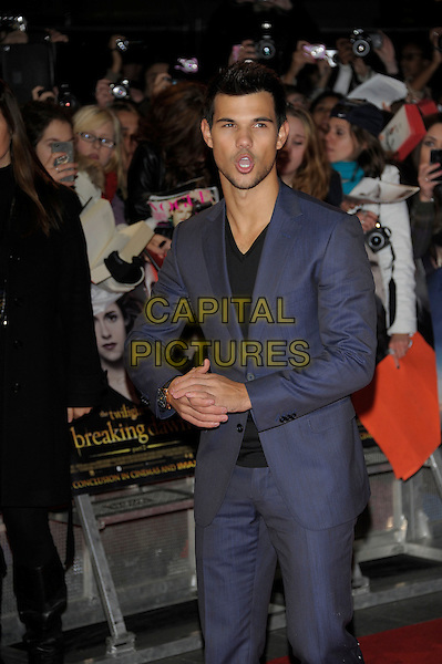 Taylor Lautner.'The Twilight Saga: Breaking Dawn Part 2' European film premiere, Empire cinema, Leicester Square, London, England..14th November 2012.half length blue suit black top stubble facial hair hands arms mouth open funny .CAP/PL.©Phil Loftus/Capital Pictures.
