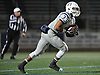 Oceanside No. 33 Brandy Diaz fields a kickoff during a Nassau County varsity football Conference I semifinal against Massapequa at Hofstra University on Saturday, Nov. 14, 2015. Oceanside won by a score of 31-22 to advance to the county final for the first time since 1977.<br /> <br /> James Escher