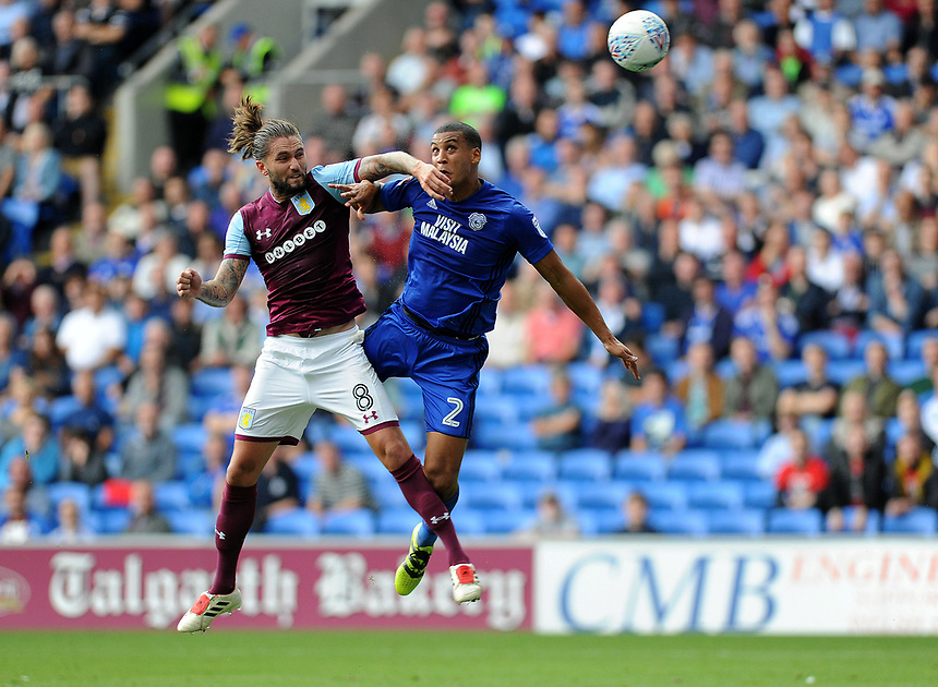 Aston Villa's Henri Lansbury battles for the ball with Cardiff City's Lee Peltier<br /> <br /> Photographer Ashley Crowden/CameraSport<br /> <br /> The EFL Sky Bet Championship - Cardiff City v Aston Villa - Saturday August 12th 2017 - Cardiff City Stadium - Cardiff<br /> <br /> World Copyright &copy; 2017 CameraSport. All rights reserved. 43 Linden Ave. Countesthorpe. Leicester. England. LE8 5PG - Tel: +44 (0) 116 277 4147 - admin@camerasport.com - www.camerasport.com