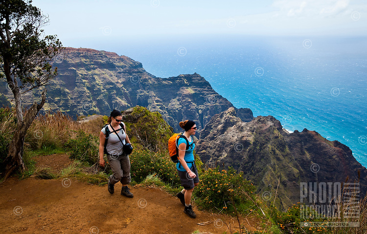 Tourists hiking on Awa'awapuhi trail, Na Pali coastline, Kauai