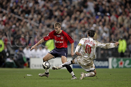 2 November 2005: Lille midfielder Mathieu Bodmer is tackled by Ruud Van Nistelrooy during the UEFA Champions League group D game between Lille and Manchester United played at the Stade de France, Paris. Lille won the match 1-0. Photo: Neil Tingle/Actionplus<br /> <br /> 051102 football soccer player losc tackle
