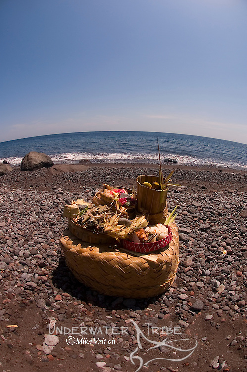 An offering given to the sea during a Hindu dedication ceremony, Tulamben, Bali, Indonesia, Pacific Ocean
