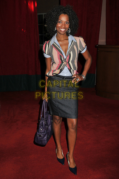 VANESSA WILLIAMS .17th Annual Women in Entertainment Power 100 Breakfast at the Beverly Hills Hotel, Beverly Hills, California, USA..December 5th, 2008.full length grey gray skirt hand on hip shirt striped stripes bag purse white jacket pink blue purple .CAP/ADM/BP.©Byron Purvis/AdMedia/Capital Pictures.