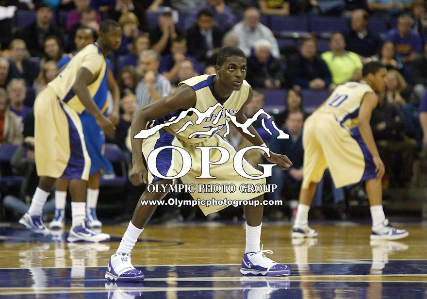 20 November 2009:  Washington Huskies forward #22 Justin Holiday (front), Clarence Trent (back row) and (right) Abdul Gaddy set up to defend against San Jose State. Washington won 80-70 over San Jose State at the Bank of America Arena in Seattle, WA.