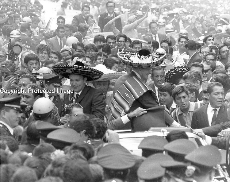 Mexico City, MEXICO - 09/23/1969 - File Photo - <br /> <br /> The Apollo 11 astronauts, Neil A. Armstrong, Edwin E. Aldrin, Jr., and Michael Collins, wearing sombreros and ponchos, are swarmed by thousands in Mexico City as their motorcade is slowed by the enthusiastic crowd. The GIANTSTEP-APOLLO 11 Presidential Goodwill Tour emphasized the willingness of the United States to share its space knowledge. The tour carried the Apollo 11 astronauts and their wives to 24 countries and 27 cities in 45 days.