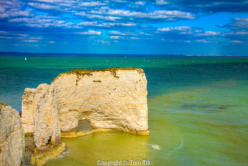 Seastack and sea arch, Jurassic Coast, Dorset, England, United Kingdom    Natural limestone arch