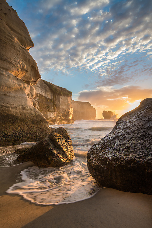 Golden sunrise light on the amazing cliffs of Tunnel Beach. Near Dunedin New Zealand - stock photo, canvas, fine art print