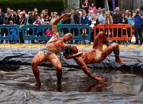 31.08.2015. Stacksteads, Lancashire, England. World Gravy Wrestling Championships. Action from today's World Gravy Wrestling championships at the Rose 'n' Bowl pub in Stacksteads, Lancashire. Contestants wrestle in a two minute long match in  1,500 litres of hot gravy.