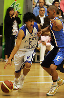 Micah Lepaio looks to get past Poutuuterangi Edwards during the NZ Secondary Schools Basketball Championships match between Fraser High School and St Patricks College at Arena Manawatu, Palmerston North, New Zealand on Saturday 4 October 2008. Photo: Dave Lintott / lintottphoto.co.nz