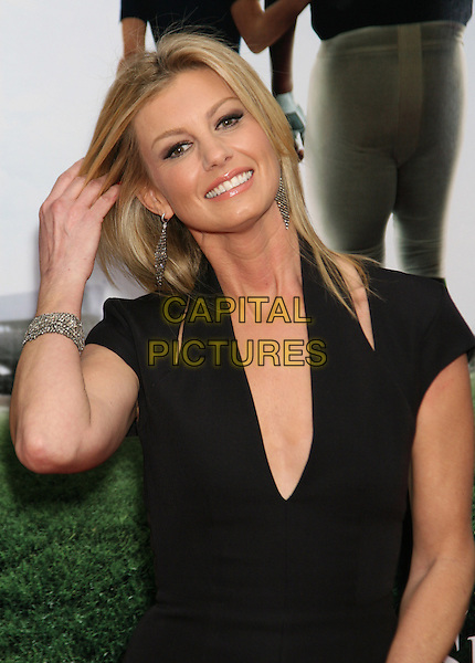 "FAITH HILL.The New York City Premiere of ""The Blind Side"" held at the Ziegfeld Theater, New York, NY, USA..November 17th, 2009.half length black cut out low plunging neckline dress shoulders slashed silver bracelet hand hair earrings .CAP/LNC/TOM.©TOM/LNC/Capital Pictures."