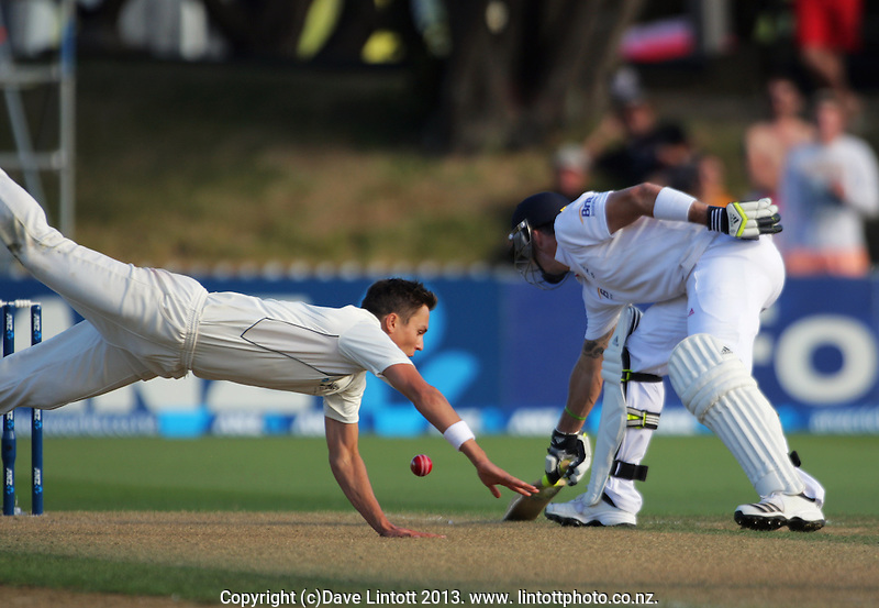 Trent Boult dives for the ball as Kevin Pietersen holds his ground during day one of the 2nd cricket test match between the New Zealand Black Caps and England at the Hawkins Basin Reserve, Wellington, New Zealand on Thursday, 14 March 2013. Photo: Dave Lintott / lintottphoto.co.nz