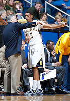 December 29th, 2012: California's Head Coach Mike Montgomery confers with Tyrone Wallace during a game against Harvard at Haas Pavilion in Berkeley, Ca Harvard defeated California 67 - 62