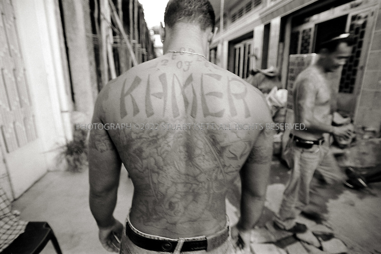 11/25/2006--Phnom Penh, Cambodia..'Popeye' and his Khmer gang tattoos in the 'hood' an area behind the Russian embassy where many deportees have settled in Phnom Penh...Photograph By Stuart Isett.All photographs ©2006 Stuart Isett.All rights reserved.