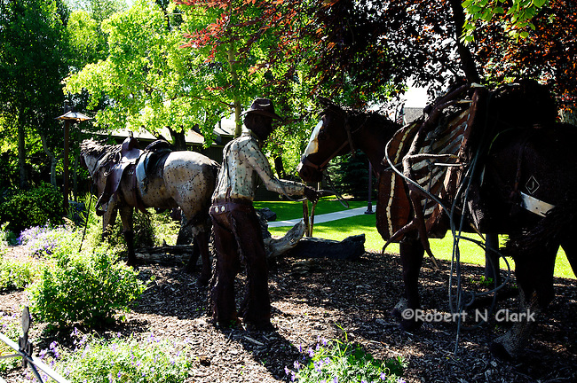 Ennis, Montana, located on the Madison River in Southwest Montana  Here is a metal sculpture of a cowboy, his horse and a packhorse.