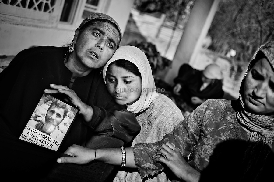 Talisma (28) and Kolsuma (21), holding the picture of their father disappeared  during the clashes in the 90', 14, November 2010,Zogyar village, Baramulla district, Kashimr. They never found the body.