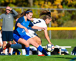 BURLINGTON ,  CT-101519JS12-  Lewis Mills' Alyse Pasqualini (18) and Newington's Karissa Zocco (3) battle for the ball during their game Tuesday at Nassahegan Field in Burlington. <br /> Jim Shannon Republican-American