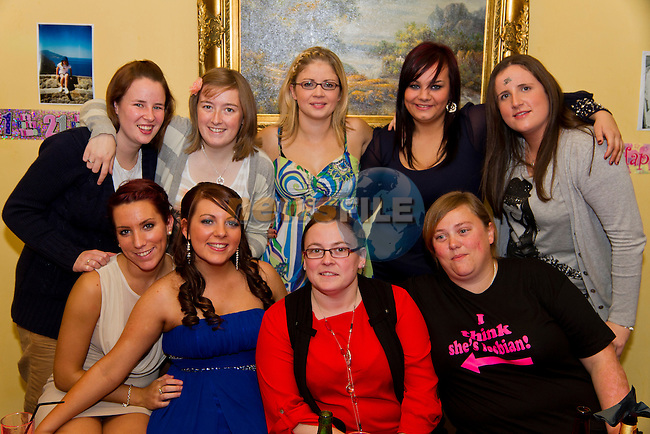 Orlith and Theresa Reilly both celebrate their 21st and 50th birthdays together in Star and Crescent. Pictured are Orlith (second from left, front row) with some of her friends on the night..Picture: Shane Maguire / www.newsfile.ie