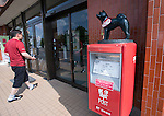 Photo shows a post box atop of which is perched a small sculpture of an Akita Inu in Odate City, Akita Prefecture Japan. Photographer: Rob Gilhooly