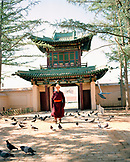 MONGOLIA, monk walking in Gandan Monastery