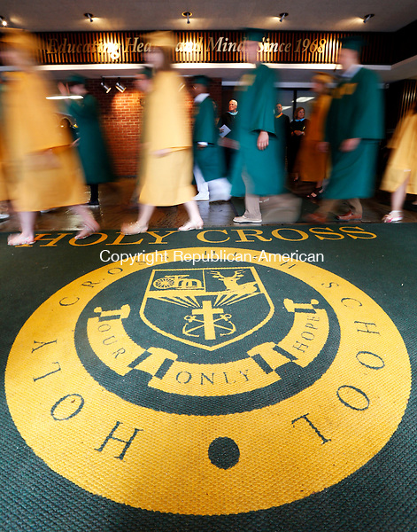 Waterbury, CT- 31 May 2015-053115CM04- Holy Cross High School graduates enter the gymnasium during the start of commencement exercises at Holy Cross High School in Waterbury on Sunday.  Christopher Massa Republican-American