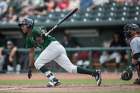 Great Lakes Loons outfielder Carlos Rincon (40) follows through on his swing against the Bowling Green Hot Rods during the Midwest League baseball game on June 4, 2017 at Dow Diamond in Midland, Michigan. Great Lakes defeated Bowling Green 11-0. (Andrew Woolley/Four Seam Images)