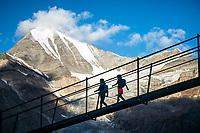 Runners crossing the world's longest suspension bridge, the Europaweg Bridge, while on the Via Valais, a multi-day trail running tour connecting Verbier with Zermatt, Switzerland.