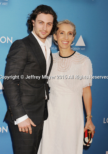 LOS ANGELES, CA - MAY 30: Actor Aaron Taylor-Johnson (L) and wife filmmaker Sam Taylor-Johnson arrive at the 2015 MOCA Gala presented by Louis Vuitton at The Geffen Contemporary at MOCA on May 30, 2015 in Los Angeles, California.