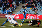 Getafe´s Diego Castro assists Pedro Leon to score a goal during 2014-15 La Liga match at Alfonso Perez Coliseum stadium in Getafe, Spain. February 08, 2015. (ALTERPHOTOS/Victor Blanco)