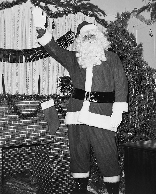Staff member dressed up as Santa Claus at Congressman's office around Christmas. (Photo by CQ Roll Call via Getty Images)