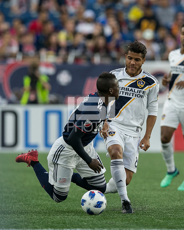 Foxborough, Massachusetts - July 14, 2018: First half action. In a Major League Soccer (MLS) match, New England Revolution (blue/white) vs Los Angeles Galaxy (white), at Gillette Stadium.