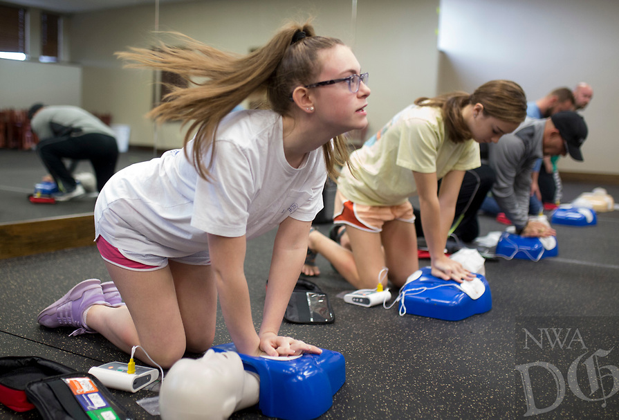 NWA Democrat-Gazette/CHARLIE KAIJO Nicole Resta 14 of Rogers (left) practices chest compressions during a CPR and AED training, Sunday, January 21, 2018 at Shadow Valley NWA in Rogers.<br />