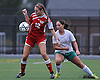 Center Moriches No. 12 Catherine Nolan, left, keeps a ball in front of her as Carle Place No. 4 Catherine Gambino pressures her during the varsity girls' soccer Class B Long Island Championship at Adelphi University on Saturday, November 7, 2015. Center Moriches won 3-2 in overtime.