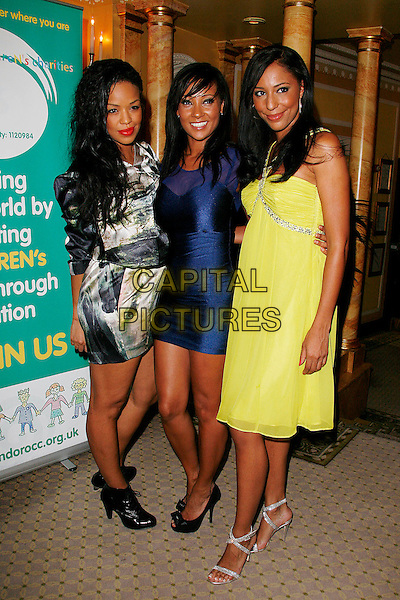 SARAH LEWIS, LISA MAFFIA & SU-ELISE NASH .Attends the Ndoro Children's Charities fundraising gala at The Dorchester Hotel, London, England, UK..September 17th, 2009.full length long maxi dress blue sheer see through grey gray black and white print ankle boots lace-up booties silver sandals ankle strap peep toe bows heels  yellow profile silver beaded jewel encrusted embellished .CAP/DAR.©Darwin/Capital Pictures