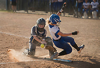 NWA Democrat-Gazette/BEN GOFF @NWABENGOFF<br /> Kennadie Stucki of Rogers slides past Gabbie Smith, Springdale Har-Ber catcher, to score in the 5th inning Thursday, April 12, 2018, during the game at Veterans Park in Rogers.