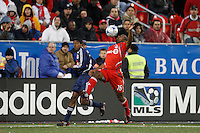 Toronto FC defender Marvell Wynne (16) plays the ball in front of New York Red Bulls midfielder Danleigh Borman (12). Toronto FC and the New York Red Bulls played to a 1-1 tie during a Major League Soccer match at BMO Field in Toronto, Ontario, Canada, on May 1, 2008.