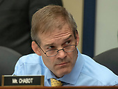 "United States Representative Jim Jordan (Republican of Ohio) listens as FBI Deputy Assistant Director Peter Strzok gives testimony during a joint hearing of the US House Committee on the Judiciary and the US House Committee on Oversight and Government Reform on ""Oversight of FBI and DOJ Actions Surrounding the 2016 Election"" on Capitol Hill in Washington, DC on Thursday, July 12, 2018. <br /> Credit: Ron Sachs / CNP<br /> (RESTRICTION: NO New York or New Jersey Newspapers or newspapers within a 75 mile radius of New York City)"