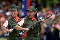 Venezuelan reserve troop female soldiers march during a military parade in Caracas, Venezuela, on Wednesday, Jul. 05, 2006. The military parade was to celebrate the 195th anniversary of the Venezuelan Independence from Spain. (ALTERPHOTOS/Alvaro Hernandez)