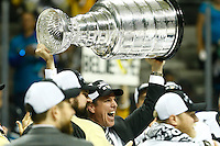 Head coach Mike Sullivan of the Pittsburgh Penguins hoists the Stanley Cup following their 3-1 win against the San Jose Sharks during game six of the Stanley Cup Final at SAP Center in San Jose, California on June 12, 2016. (Photo by Jared Wickerham / DKPS)